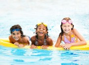 Smiling children in a swimming pool