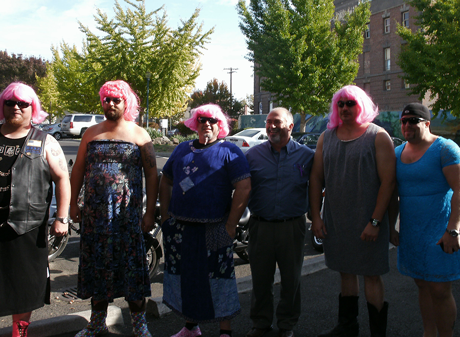 Pen volunteers pose in their dresses and wigs.