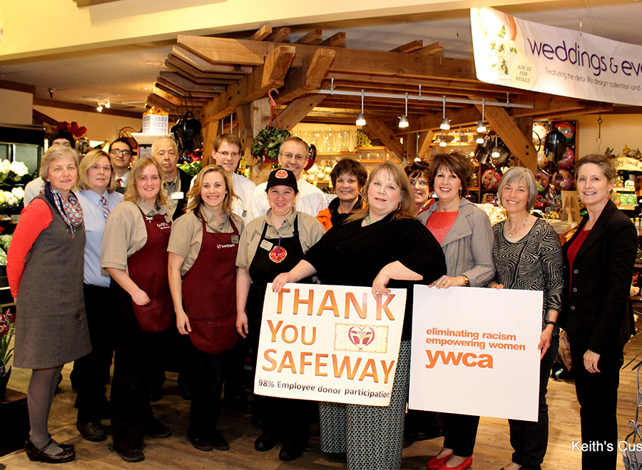 YWCA board and Safeway staff gather after handing off the first check to the YWCA.