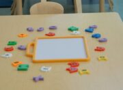 Childcare table with colorful alphabet magnets and board