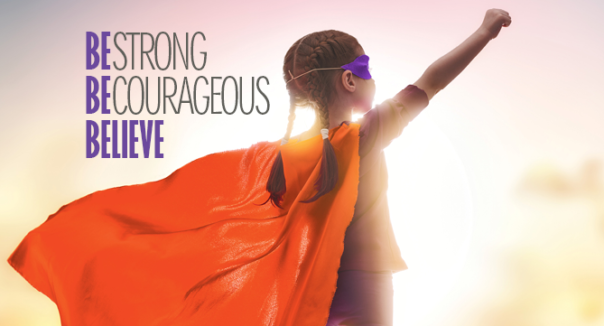 """Girl in cape with the message""""Be strong, Be courageous, Believe"""